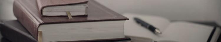 books and pen Mikhail Pavstyuk