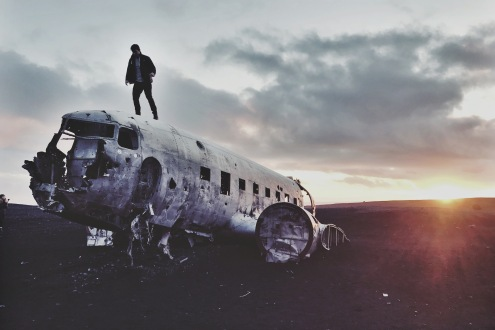 man-on-airplane-wreckage