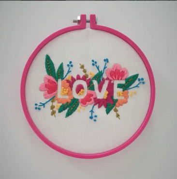 Love embroidery on white background finished